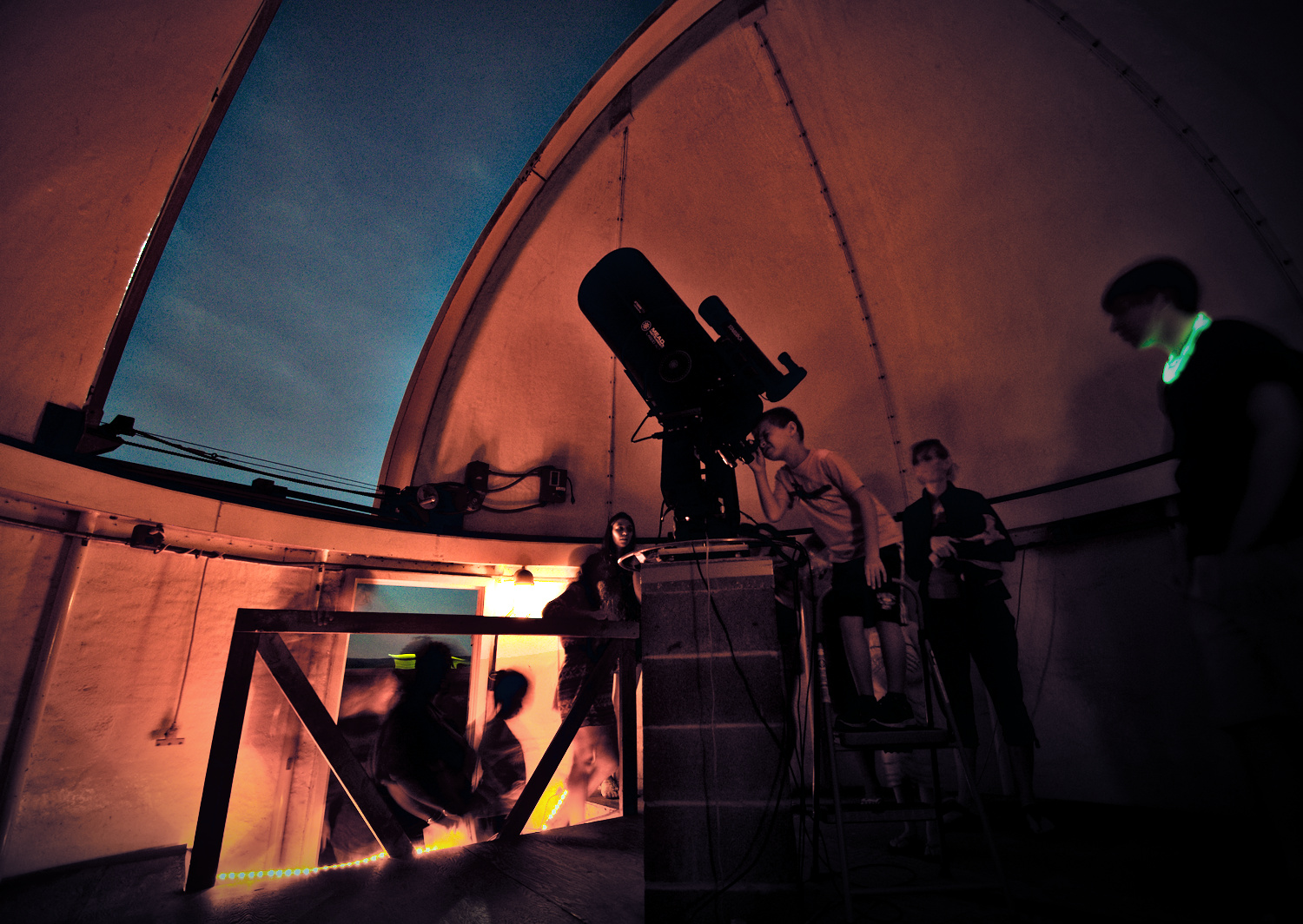 Rooftop observing - Visitors looking at the double star Albireo through one of the telescopes on top of Davey Lab.