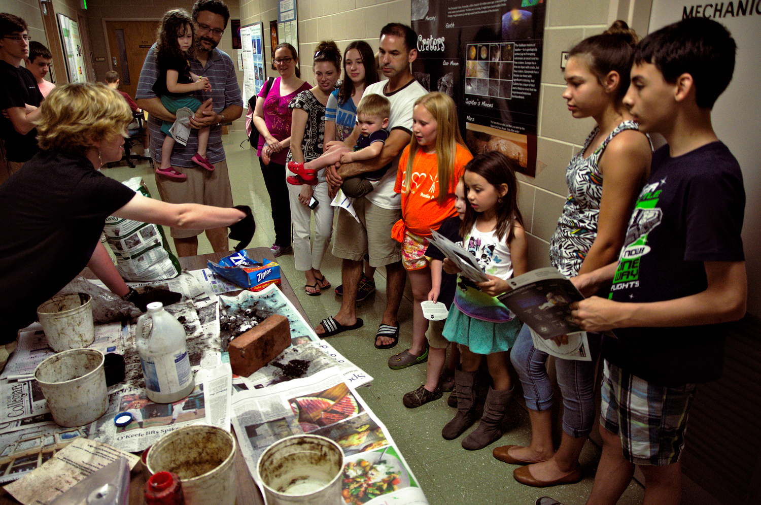 Astrofest volunteers show how to make comets.